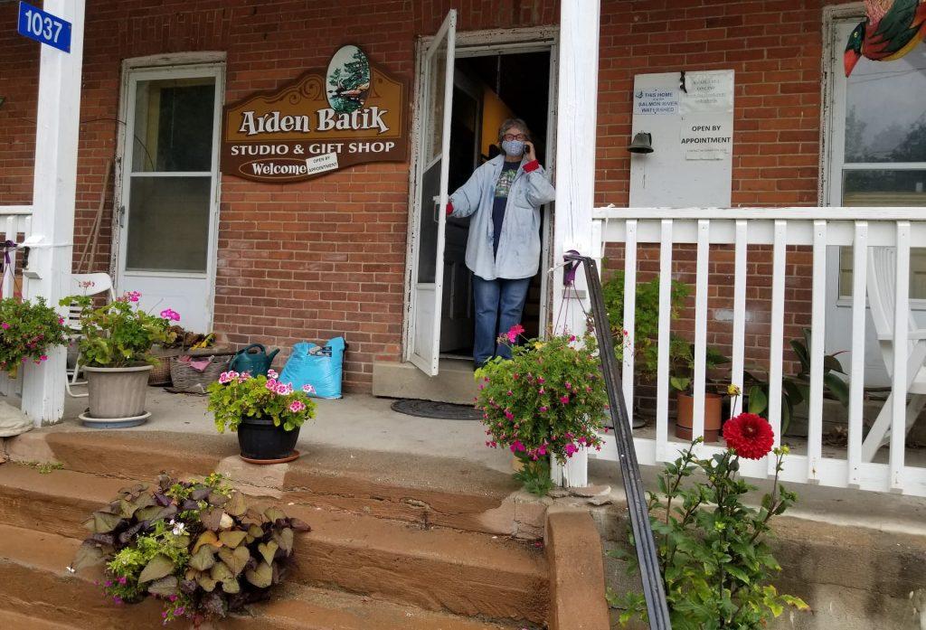 Sarah Hale standing at the front door of Arden Batik.